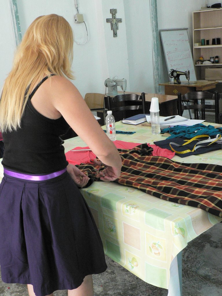 Some find quiet sanctuary in the workshop. This woman, soon at the end of a 15 year sentence, is making a new wardrobe with material donated by staff and well wishers. She's been able to leave the prison for up to a week a number of times, to acclimatize to the outside world.