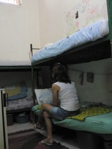 Inmate in her cell, 313 remand facility, Albania