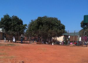 Visitors call through fence wire to inmates  in the female section of Lusaka Central Prison